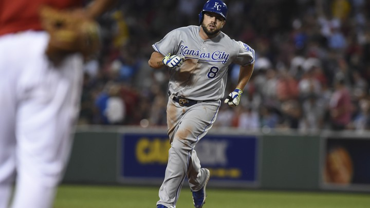 The Kansas City Royals third baseman Mike Moustakas (8) rounds the bases after hitting a three-run home run during the fourth inning against the Boston Red Sox at Fenway Park.