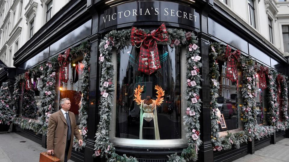 Man walks by Victoria's Secret store