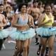 A group of runners wearing light-blue running tutus