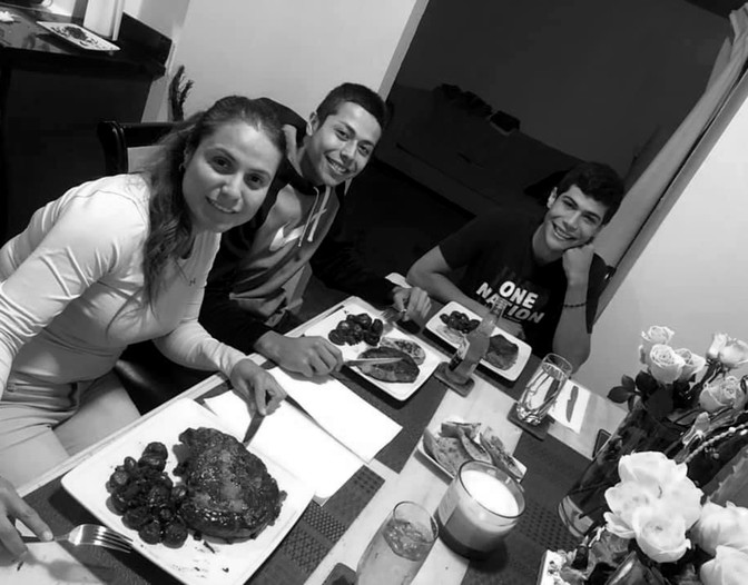 Christian Madrigal with his family having a dinner party