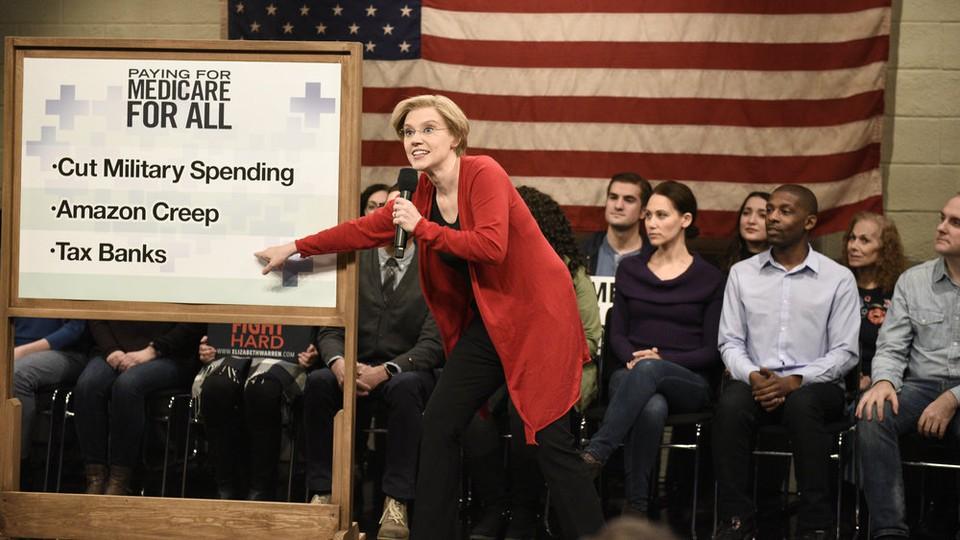 Kate McKinnon as Elizabeth Warren