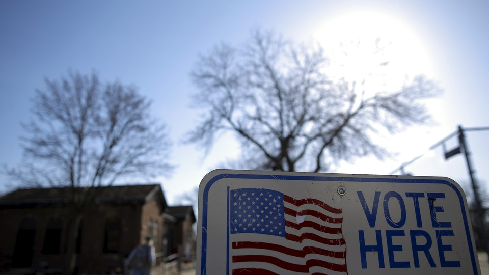 A voter arrives to cast their ballot in the Wisconsin presidential primary election at a voting station in Milwaukee, Wisconsin.