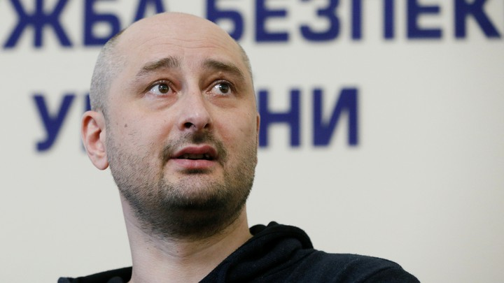 Arkady Babchenko speaking at a news conference