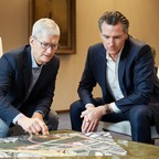 Apple CEO Tim Cook (left) and California Governor Gavin Newsom look at a map of San Jose