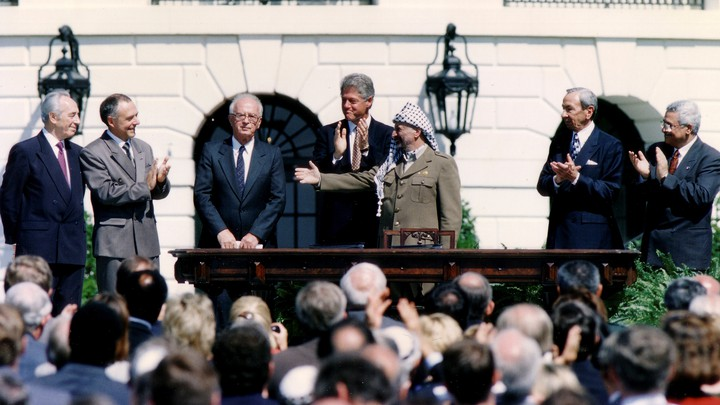Israeli Prime Minister Yitzhak Rabin, U.S. President Bill Clinton, and PLO Chairman Yasser Arafat after the signing of the Israeli-PLO peace accord on September 13, 1993