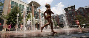 Children play in a spray park in Rockville Town Square in suburban Rockville, Maryland.