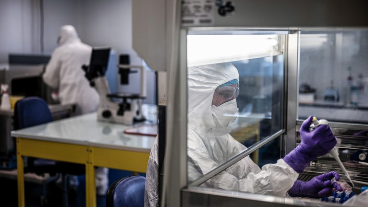 A scientist working on developing a vaccine for COVID-19.