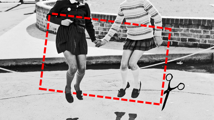 A dotted-line rectangle representing a label, with an image of scissors snipping it, overlays a black and white image of two young girls holding hands and jumping in the air