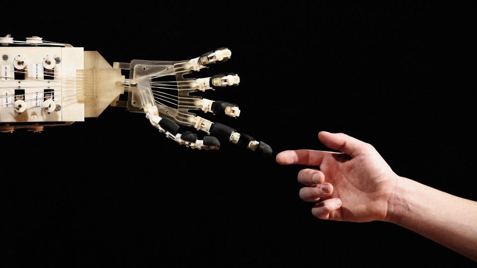 A photograph of a robotic hand reaching out to touch the finger of a human hand.