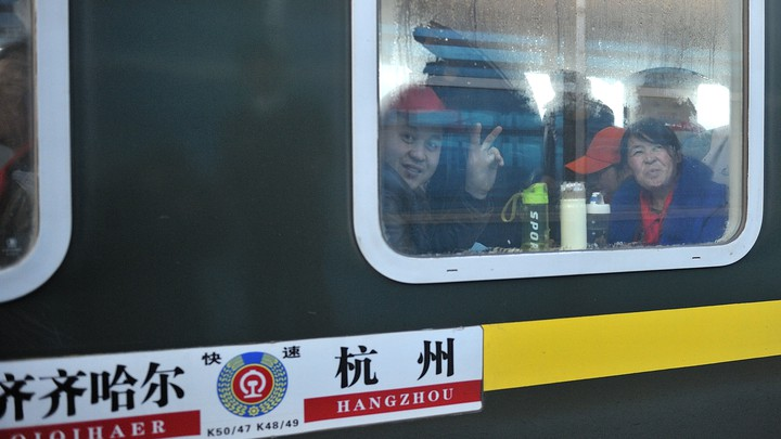 Migrants workers take a train from the city of Hangzhou to Qiqihar to celebrate the Spring Festival holiday in 2018.