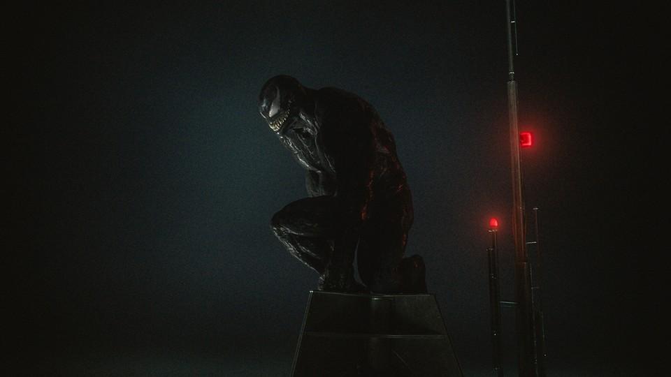 "Venom kneels in darkness in ""Venom: Let There Be Carnage."""