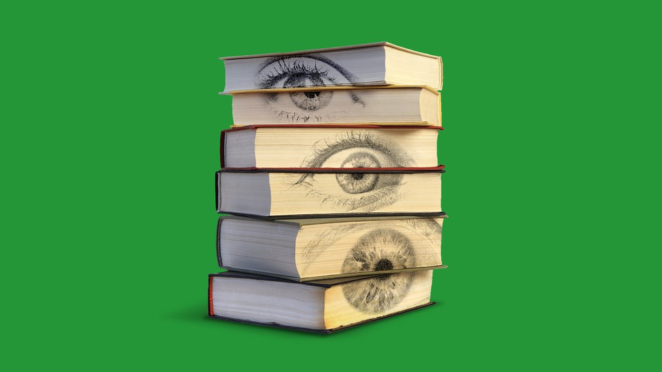 A stack of books with eyes on the pages