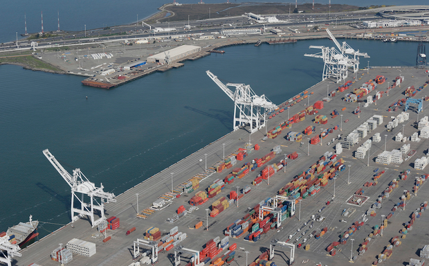 The former Oakland Army Base pier at left and the Port of Oakland at lower right in Oakland.