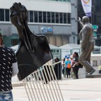 A giant Afro pick confronts former mayor Frank Rizzo in Philadelphia, part of the city's Monument Lab project.