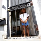 A young boy stands in the door of his home in Gary, Indiana.