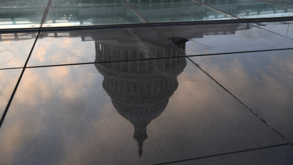 U.S. Capitol building reflected in a puddle