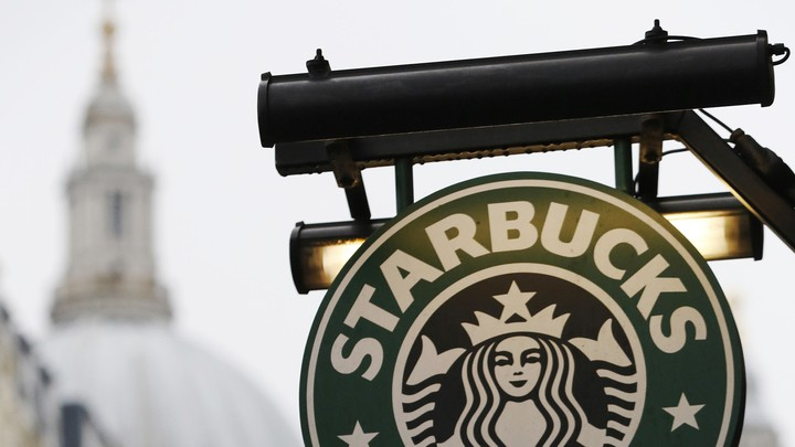 A Starbucks coffee sign near St. Paul's Cathedral in London