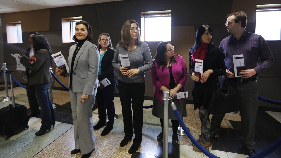 Peruvian citizens applying for U.S. visas wait in line at the American embassy in Lima.