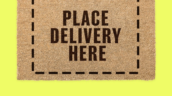 "A doormat that reads, ""PLACE DELIVERY HERE"""