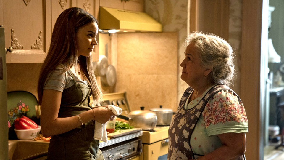 Nina and Abuela Claudia from 'In the Heights' in an apartment kitchen