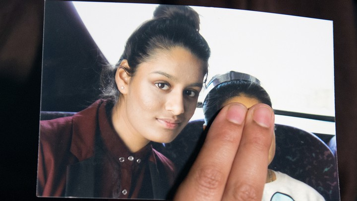 Renu Begum, the sister of Shamima Begum, holds a photo of her sister.
