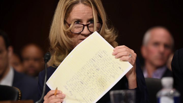 Christine Blasey Ford holding a piece of paper