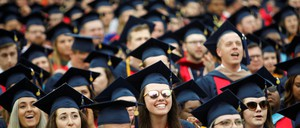 Graduates react near the end of commencement exercises at Liberty University in Lynchburg, Virginia, U.S.