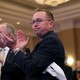 Acting White House Chief of Staff Mick Mulvaney applauds as U.S. President Donald Trump speaks at the 2019 House Republican Conference Member Retreat dinner in Baltimore, Maryland.