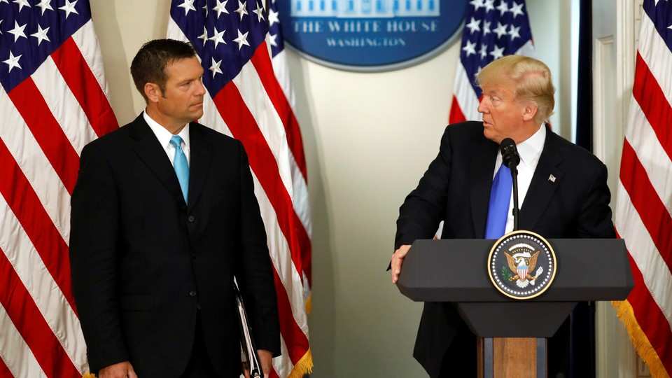 Kris Kobach and President Trump at a meeting in July