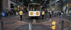 photo: San Francisco Municipal Transit Agency employees turn an empty cable car in San Francisco on March 4.