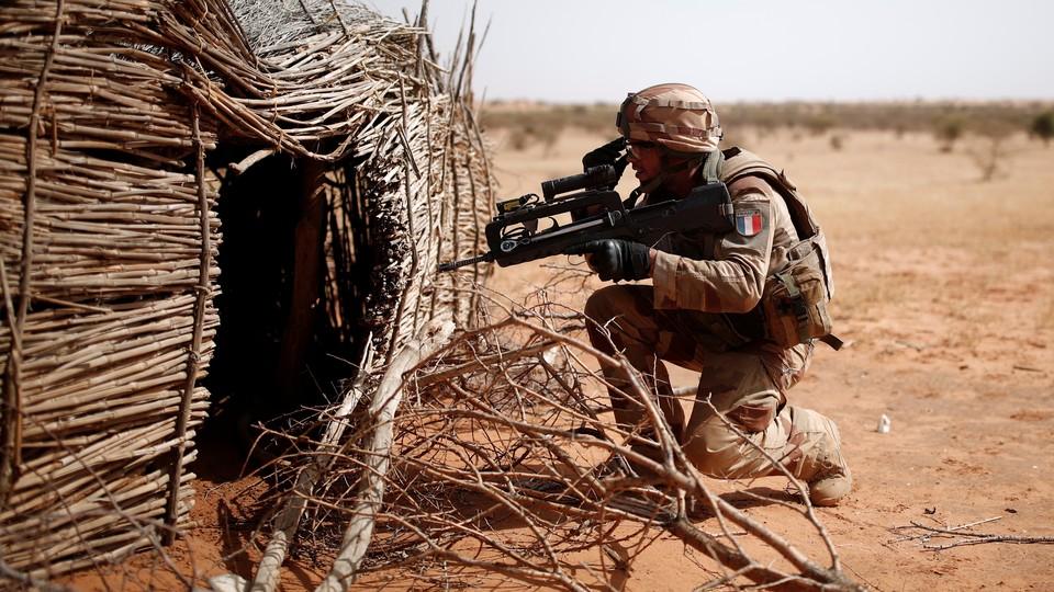 A French soldier controls a Tuareg home near Tin Hama, Mali