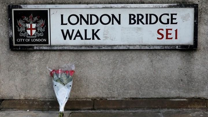 Flowers for the victims at the scene of a stabbing on London Bridge, in which two people were killed, November 30, 2019