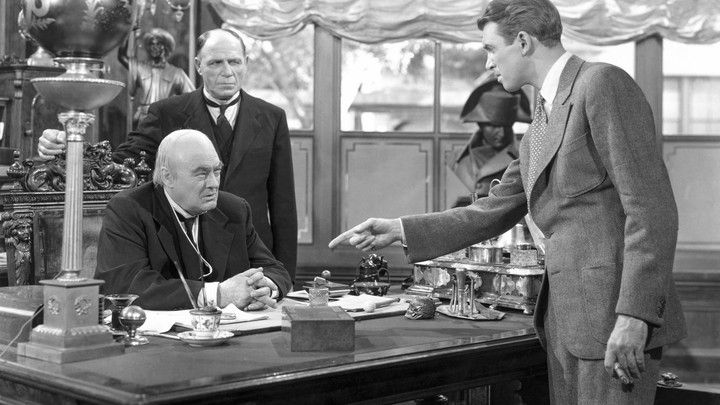 George Bailey confronts Henry Potter in a scene in 'It's a Wonderful Life'