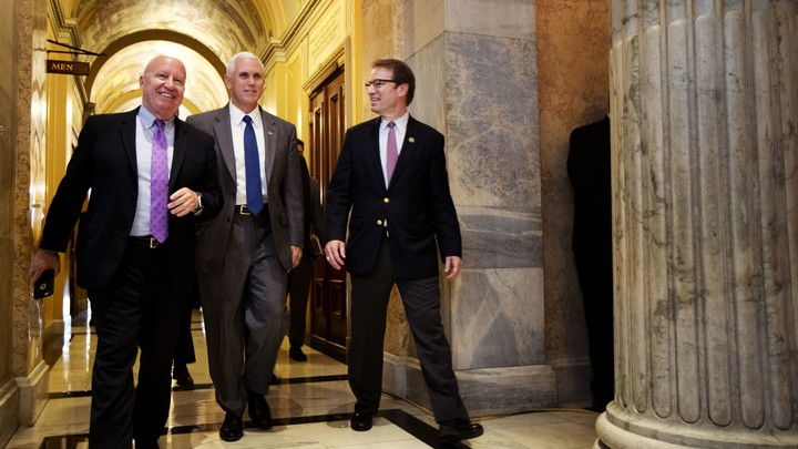 The House GOP's top tax-writers walking with Vice President Mike Pence