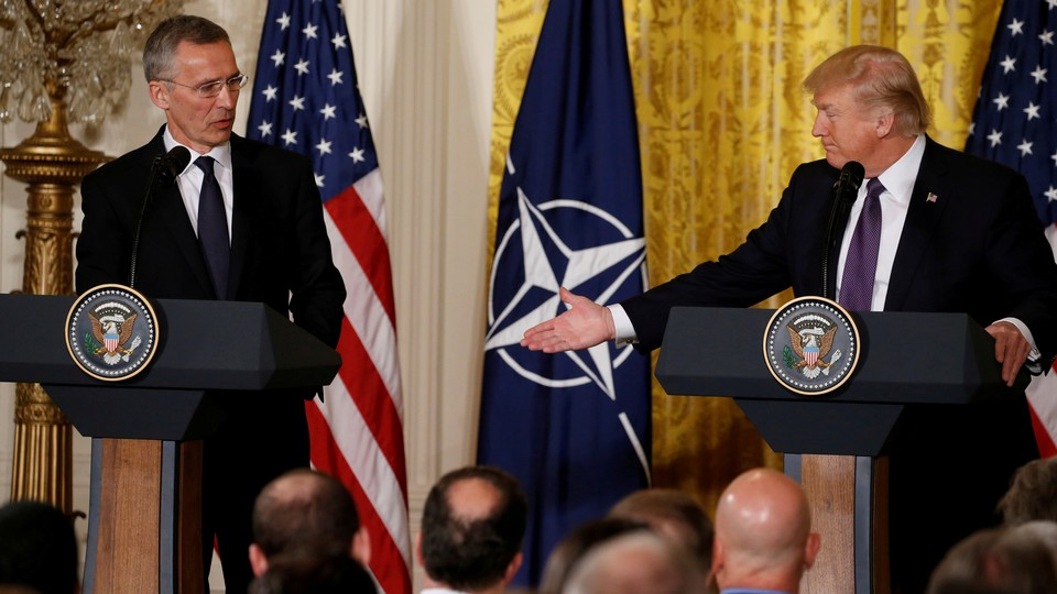 President Donald Trump and NATO Secretary General Jens Stoltenberg hold a joint news conference at the White House on April 12, 2017.