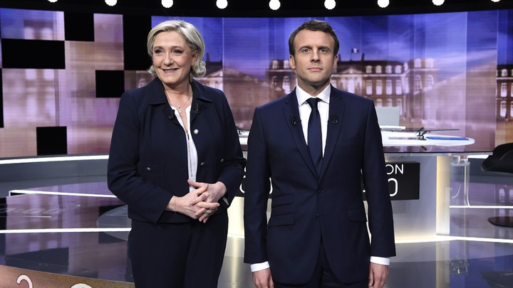 French presidential candidates Marine Le Pen and Emmanuel Macron pose ahead of their televised debate in La Plaine-Saint-Denis on May 3, 2017.