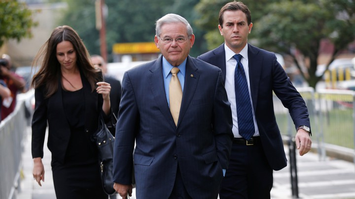 New Jersey Senator Bob Menendez pictured with two other people