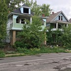 Abandoned homes in East Cleveland, where a land conservancy has been working to acquire vacant properties.