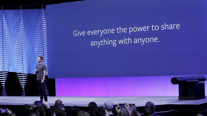 """Mark Zuckerberg stands in front of a slide that says """"Give everyone the power to share anything with anyone."""""""