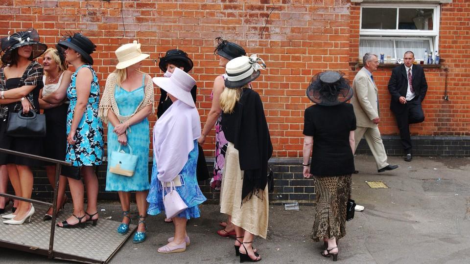 women wait in line for the bathroom