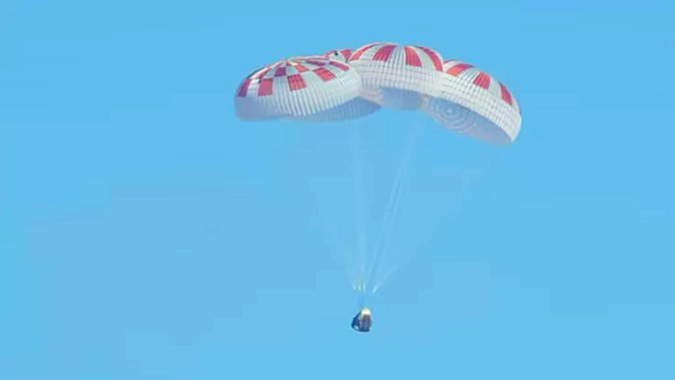 Parachutes soften the descent of SpaceX's Dragon spacecraft on its return to Earth.