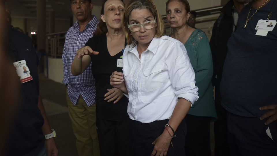 Mayor Carmen Yuliín Cruz visits a hospital in San Juan Saturday, after electrical outages requires patient evacuations.