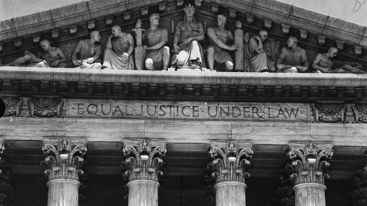 "The phrase ""Equal Justice Under Law"" carved into the pediment of the Supreme Court Building in Washington"