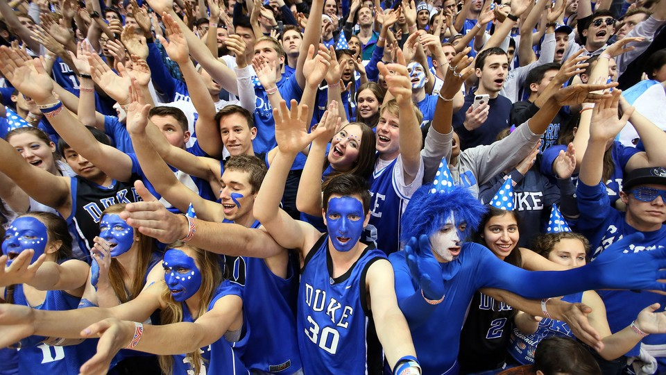 Fans with blue face paint and spirited outfits cheer on the Duke Blue Devils.