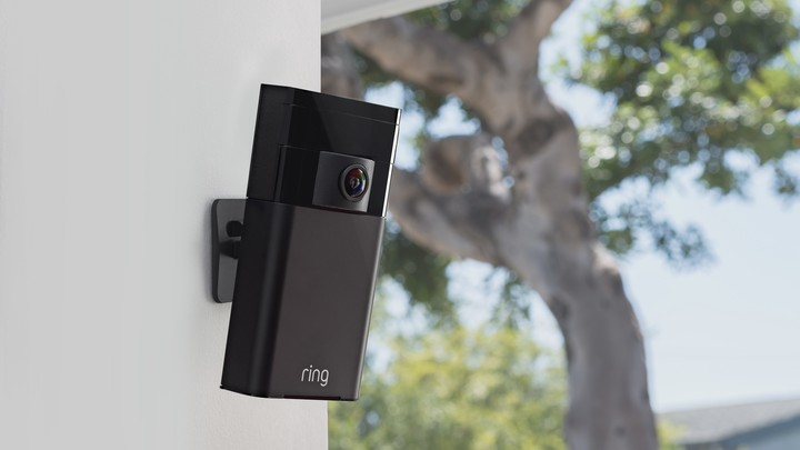 An Amazon Ring camera mounted on an outdoor wall