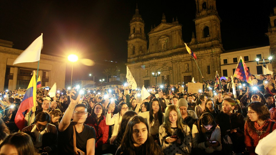 Supporters of the peace deal signed between the government and the FARC rebels gather at Bolivar Square during a march for peace in Bogota, Colombia, on October 20, 2016.