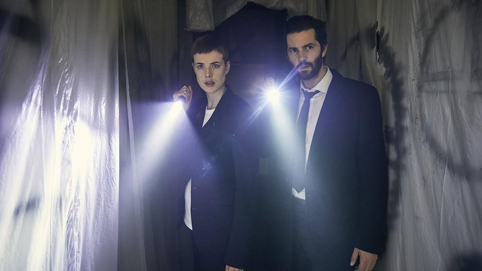 Agyness Deyn and Jim Sturgess with flashlights in a still from 'Hard Sun'