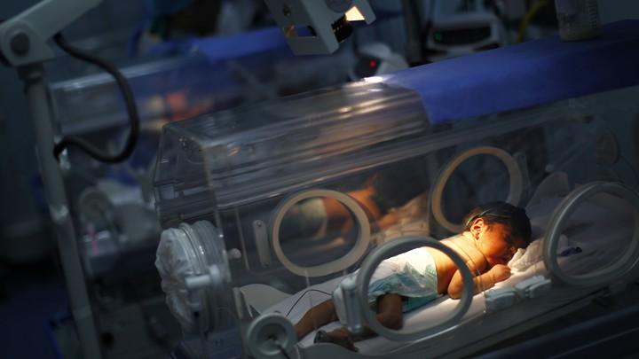 Baby sleeping in an incubator