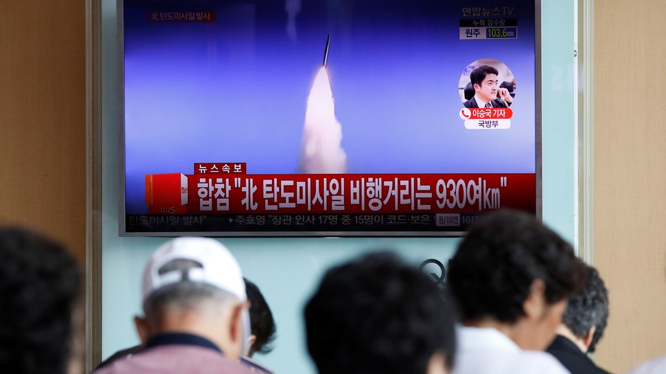 People watch a TV broadcast of North Korea's ballistic missile test in Seoul, South Korea on July 4.