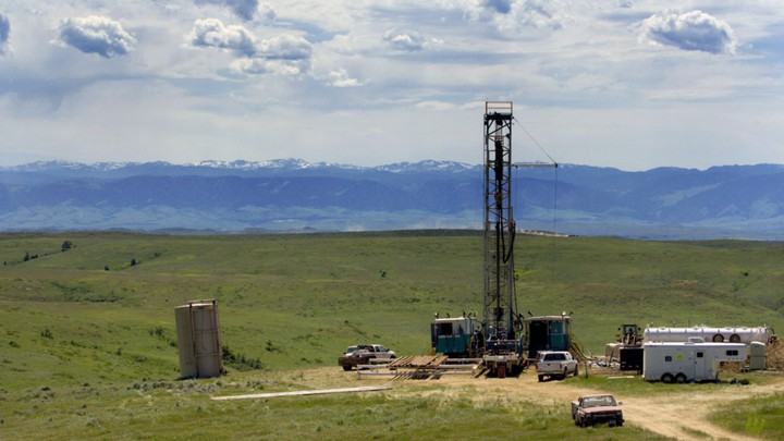 A drilling rig backed by mountains in Wyoming